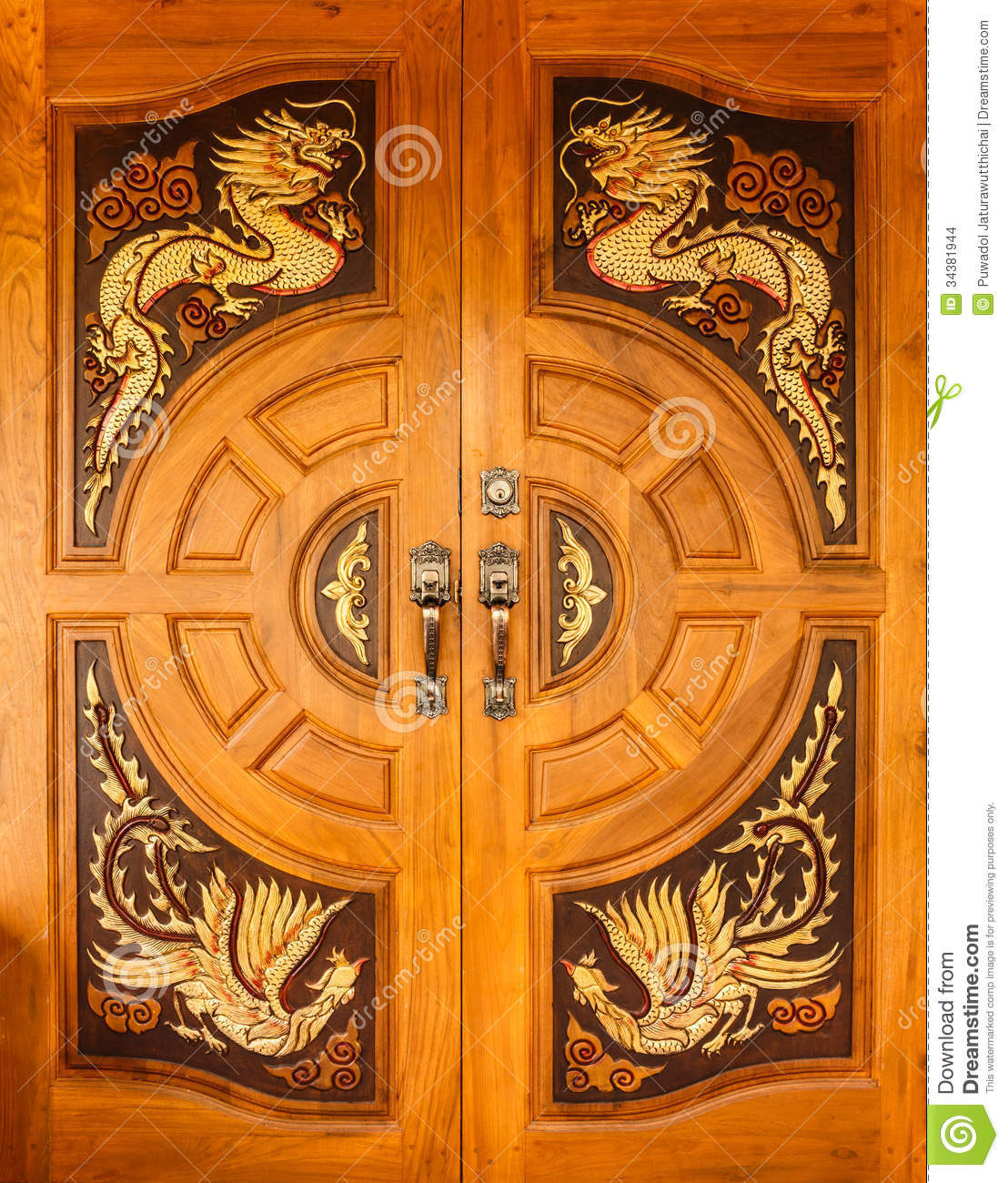 Wood Door With Dragons And Swans Design Stock Photo