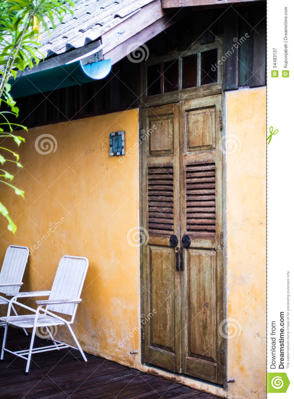 Wood door in orange stucco house royalty free stock for Outer doors for homes