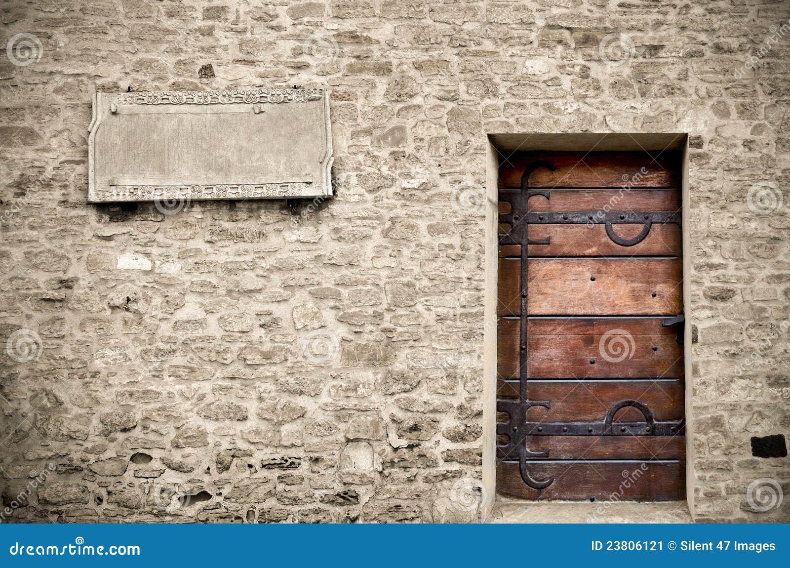 Wood Door On Stone Wall Stock Image Image 23806121