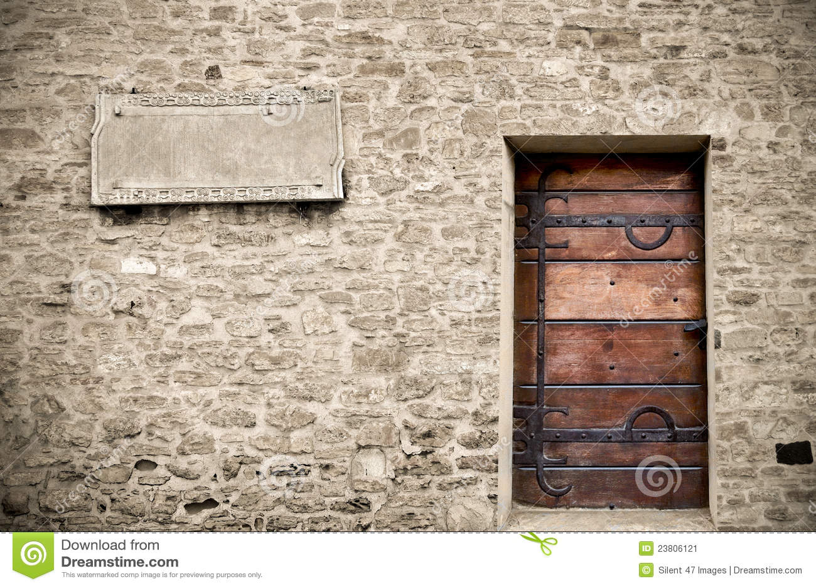 Wood door on stone wall stock image image 23806121 for Door of stone