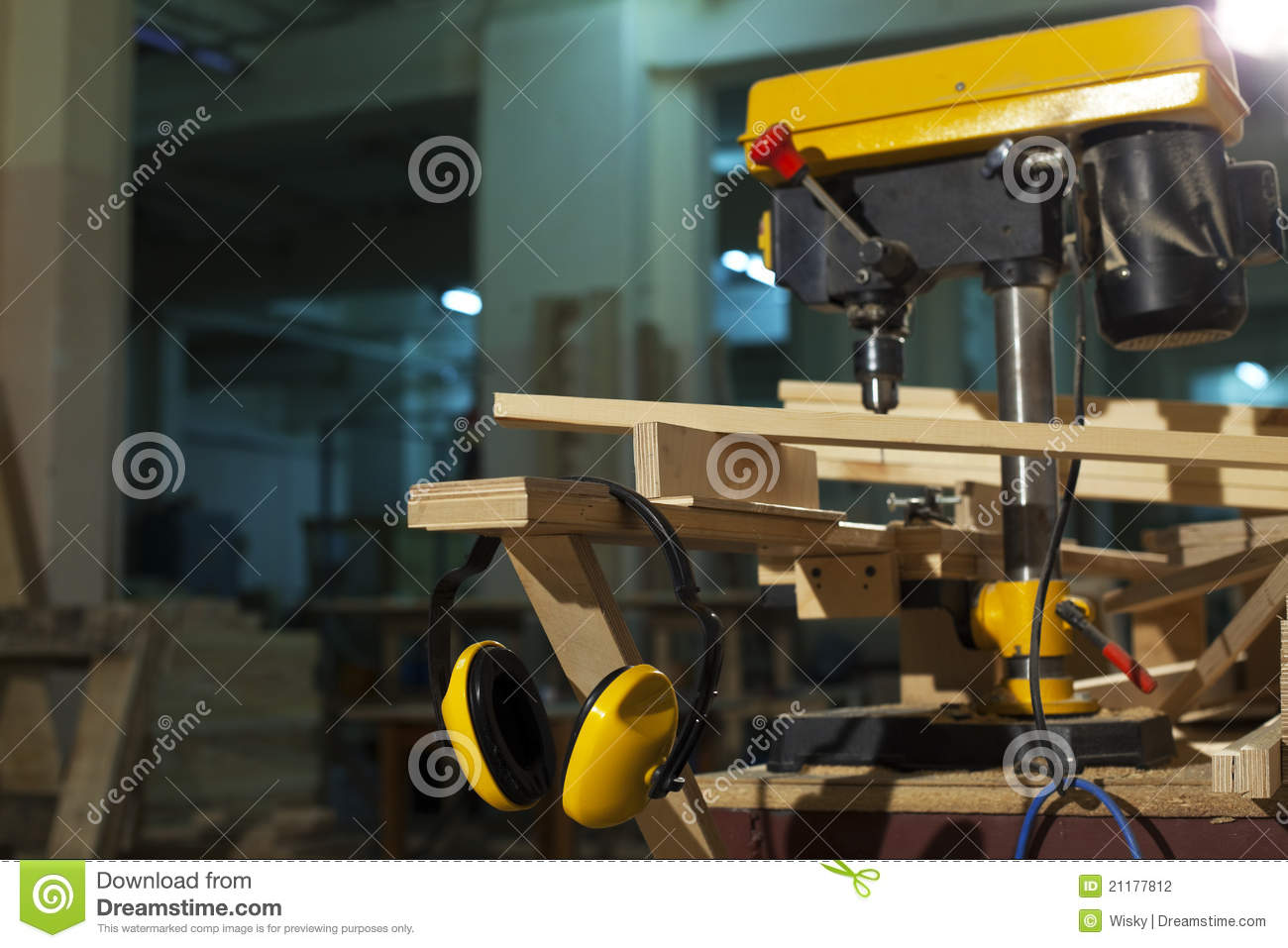 Wood drill and protective headphones