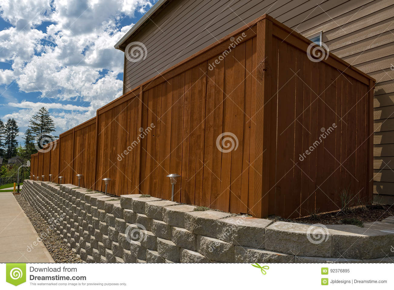 Wood Fence And Cement Blocks Retaining Wall Stock Image