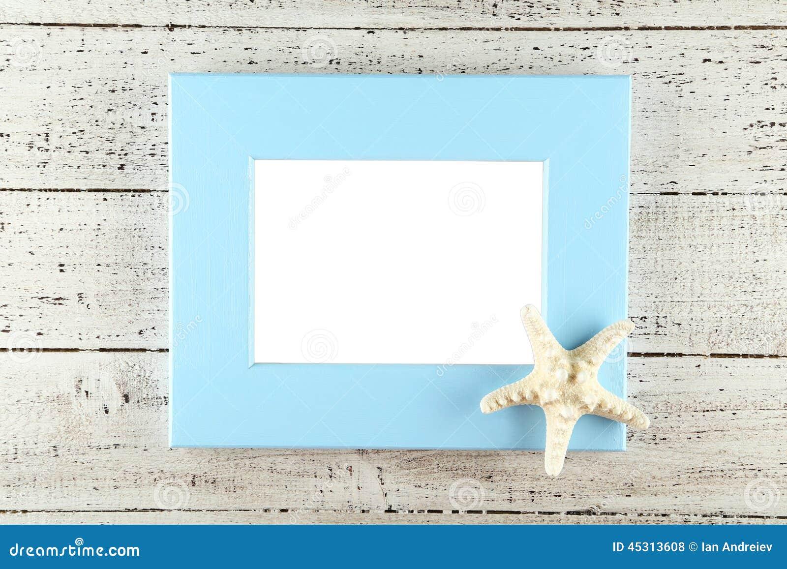 Wood frame on white wooden background.