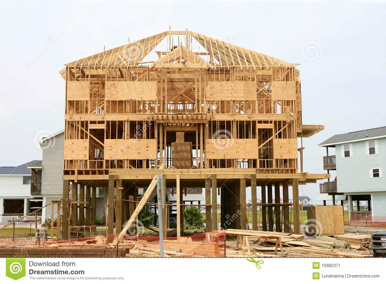 Wood house contruction american wooden structure stock for Dream wooden house