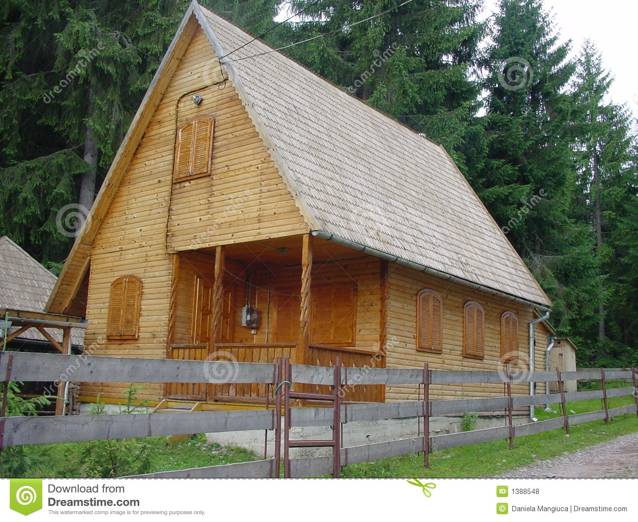 Wood House With Log Walls And Shigle Roof Royalty Free