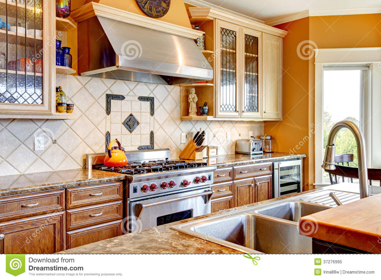 Wood Kitchen Room With Decorated Tile Backsplash Royalty Free