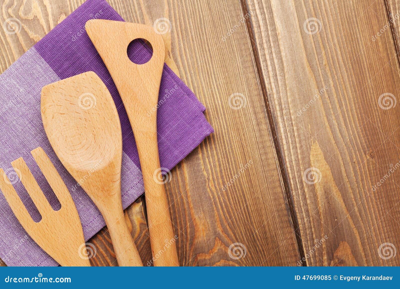 Wood kitchen utensils over wooden table background stock for Table utensils