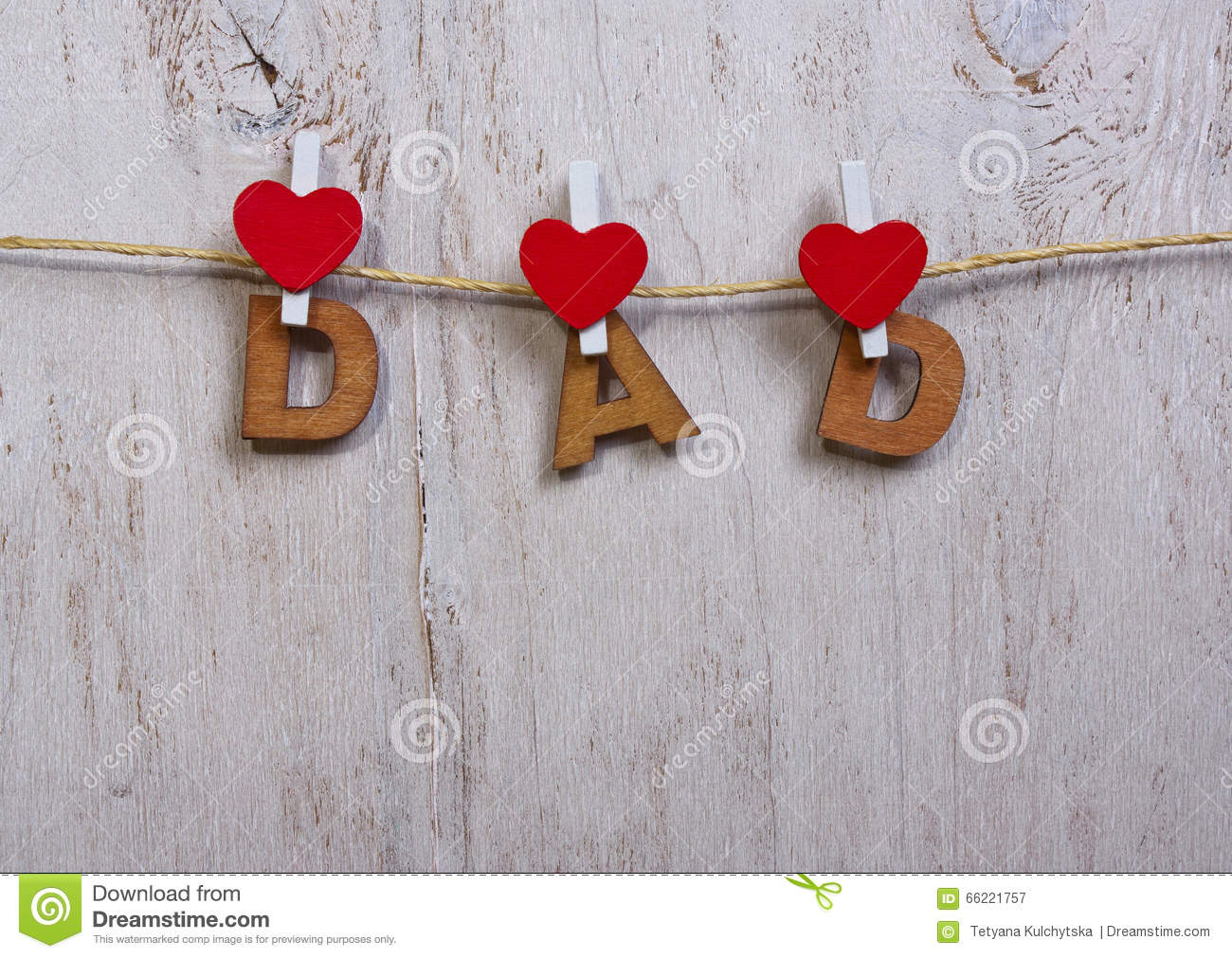 wood letters and heart forming phrase dad