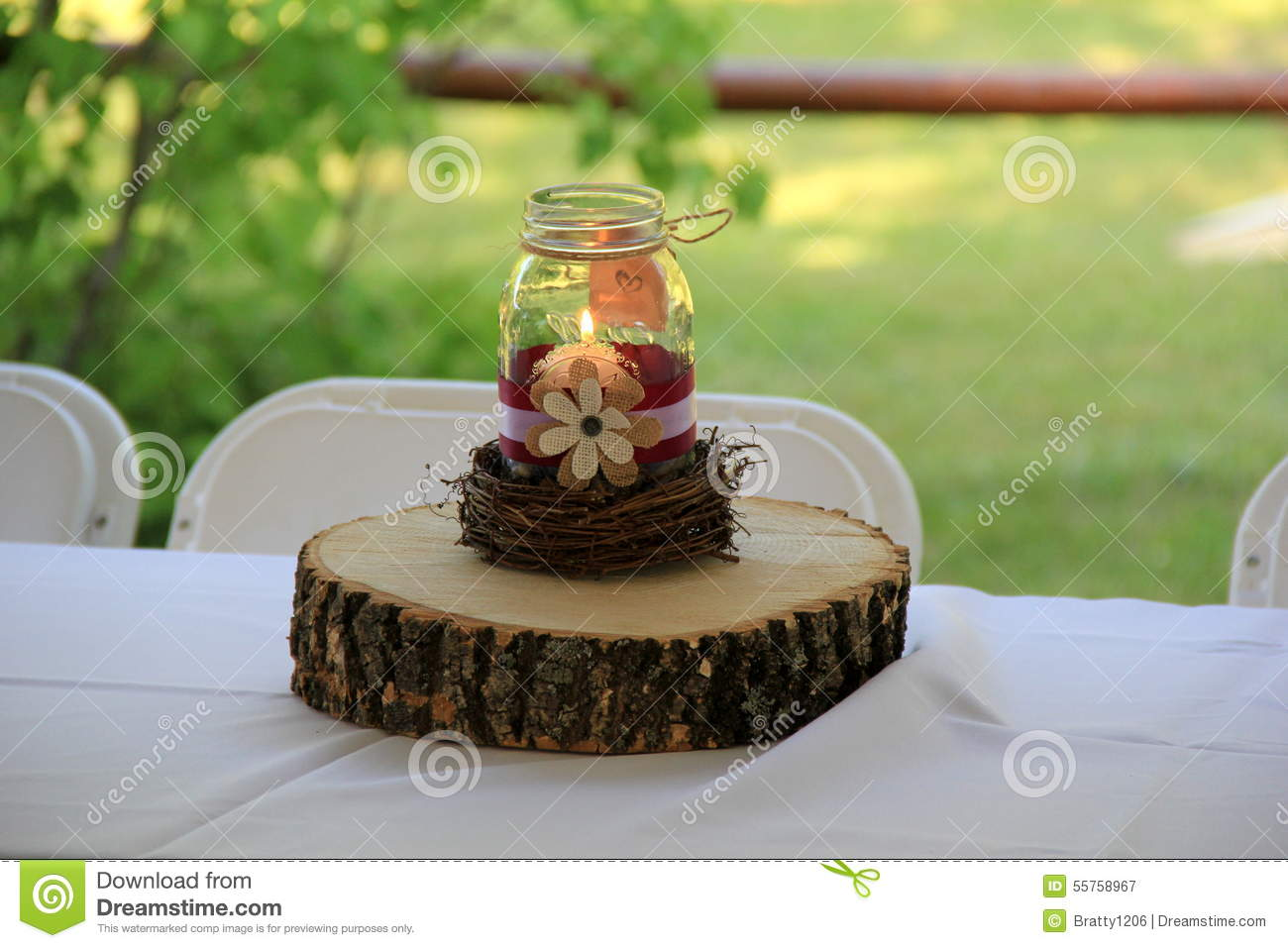 Wood And Mason Jar Candle Centerpiece On Head Table At