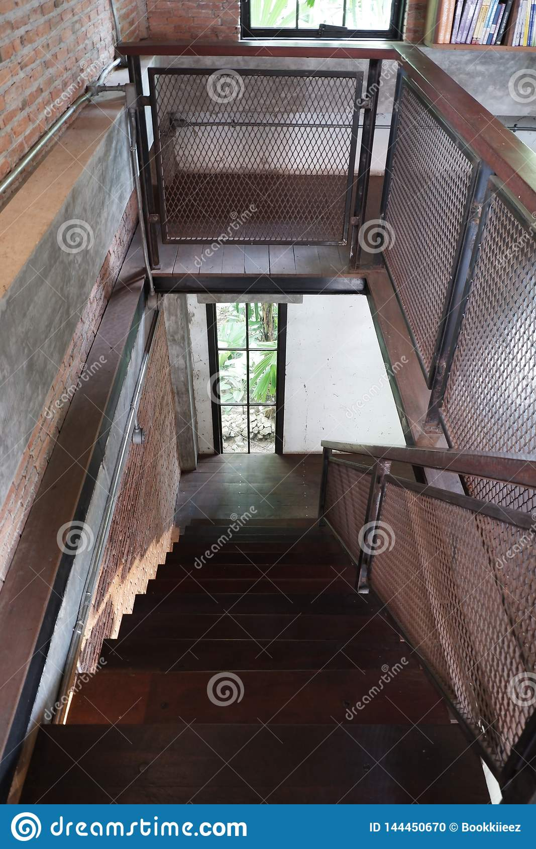 Wood with metal of loft stair in house.