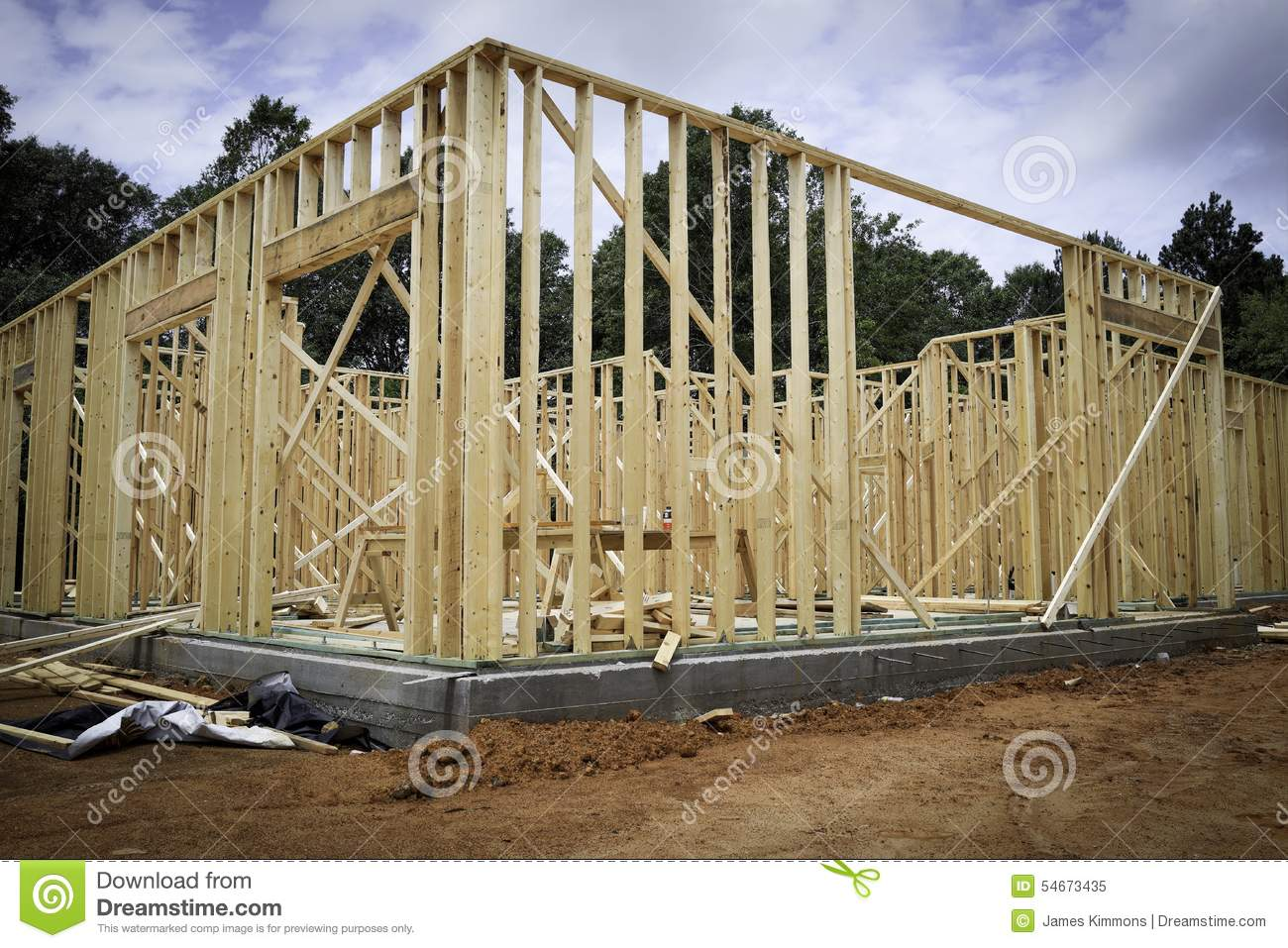 Wood new home framing stock photo image 54673435 for Exterior framing