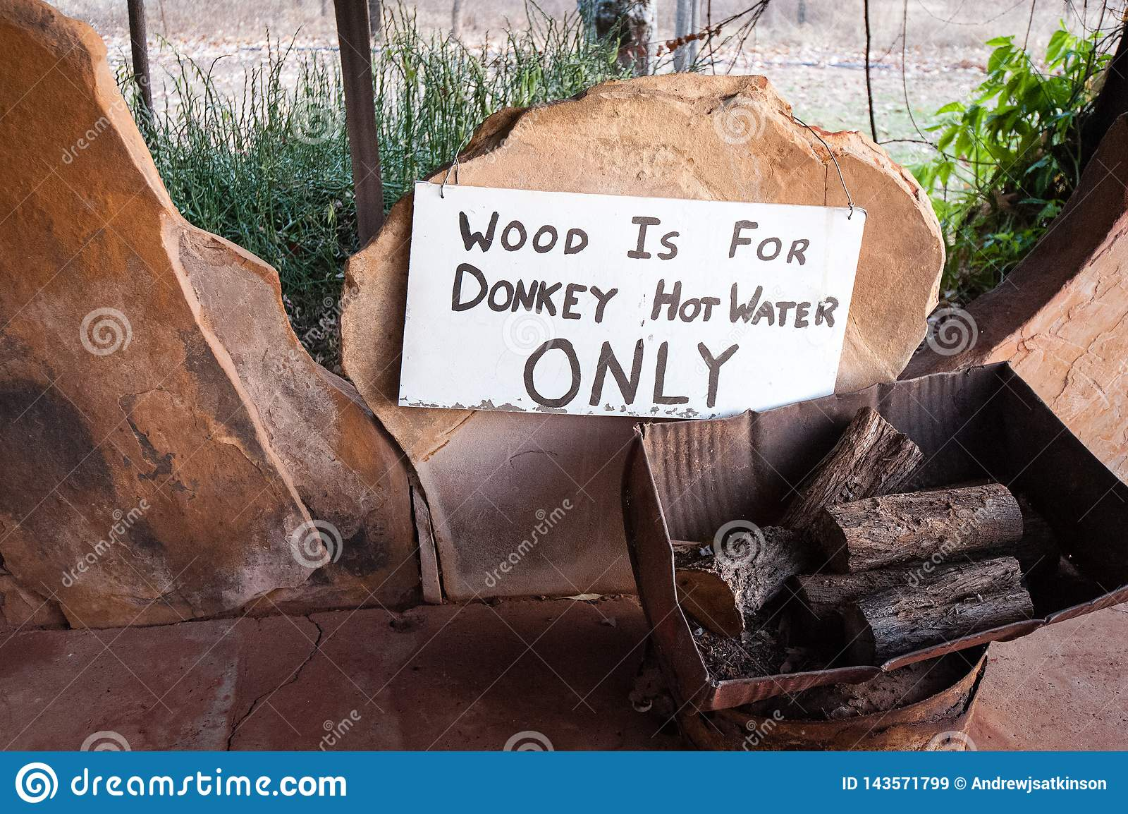 Wood pile labeled for use in the donkey hot water system