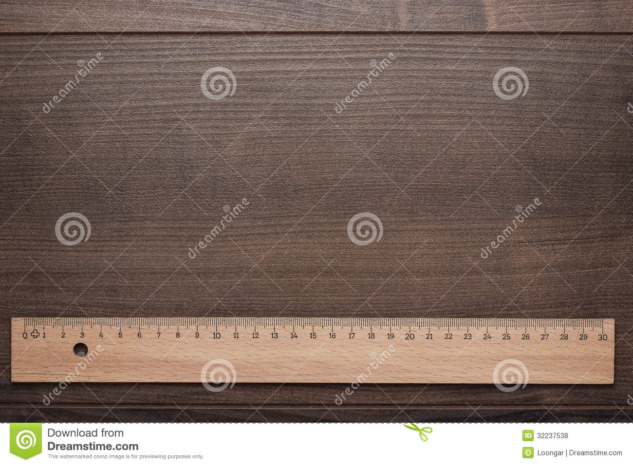 Wood ruler on the wooden background
