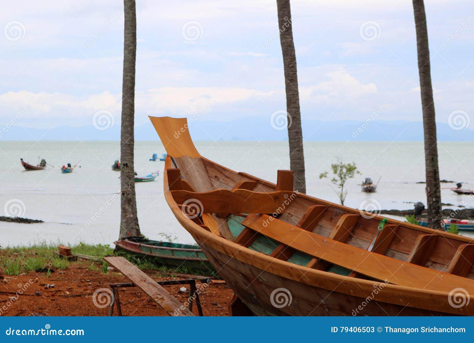 Wood shipbuilding near the sea.