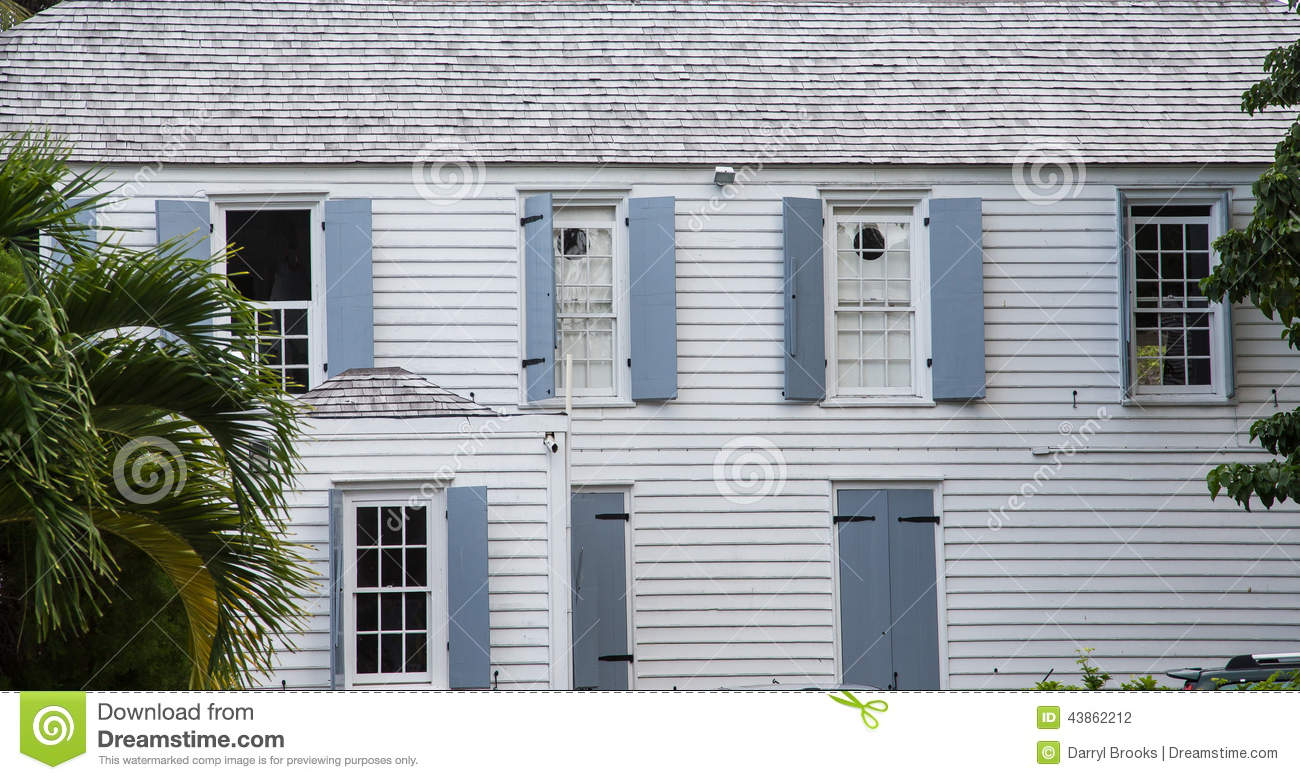 Wood Siding Building With Grey Shutters