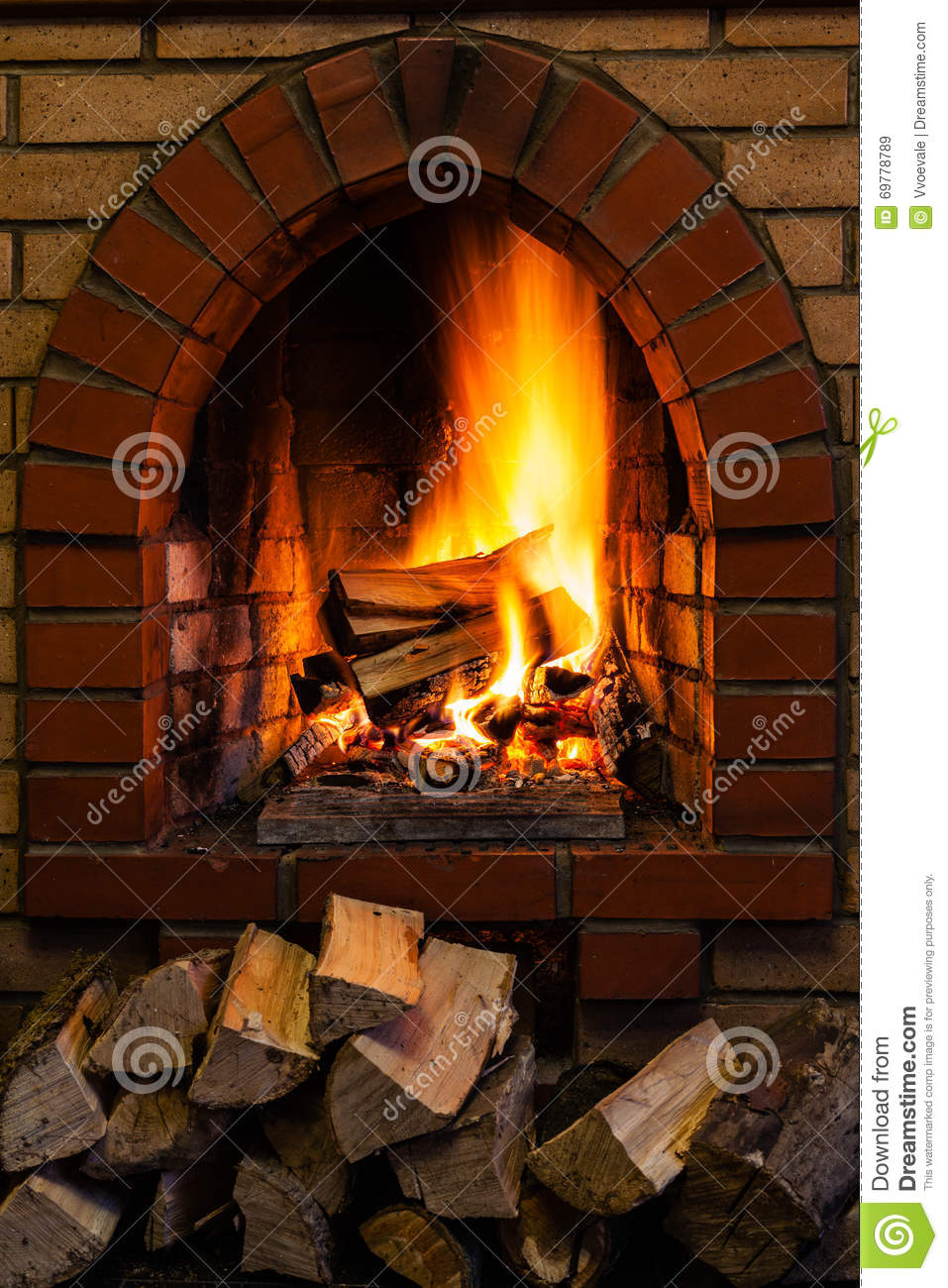 Wood Stack And Logs Burning In Brick Fireplace Stock Image Image