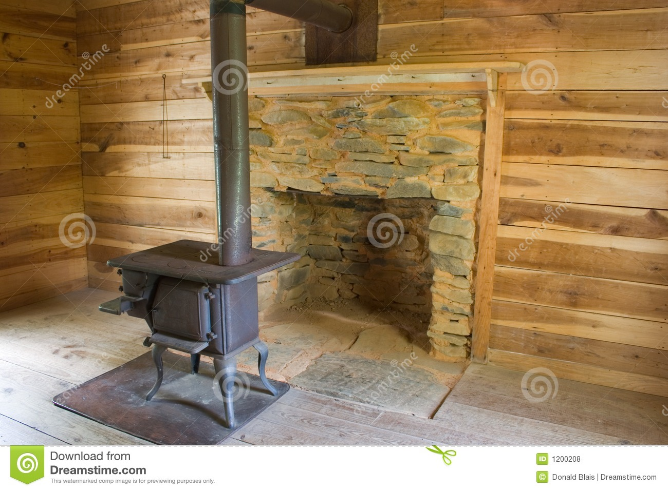 Wood Stove In Log Cabin_4913-1S Stock Photo - Image of cabin, home on log cabin fireplace screens, log cabin fireplace mantels, log cabin electric fireplaces, log cabin fireplace tools, log cabin rock fireplaces, log cabin fireplace designs,