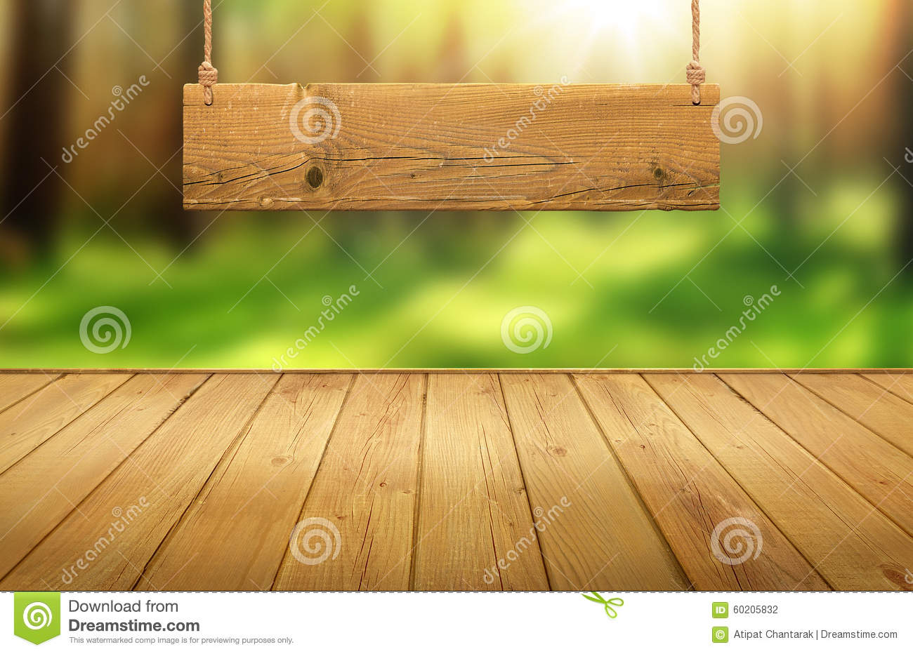 Background image table - Wood Table With Hanging Wooden Sign On Green Forest Blurred Background Stock Photography