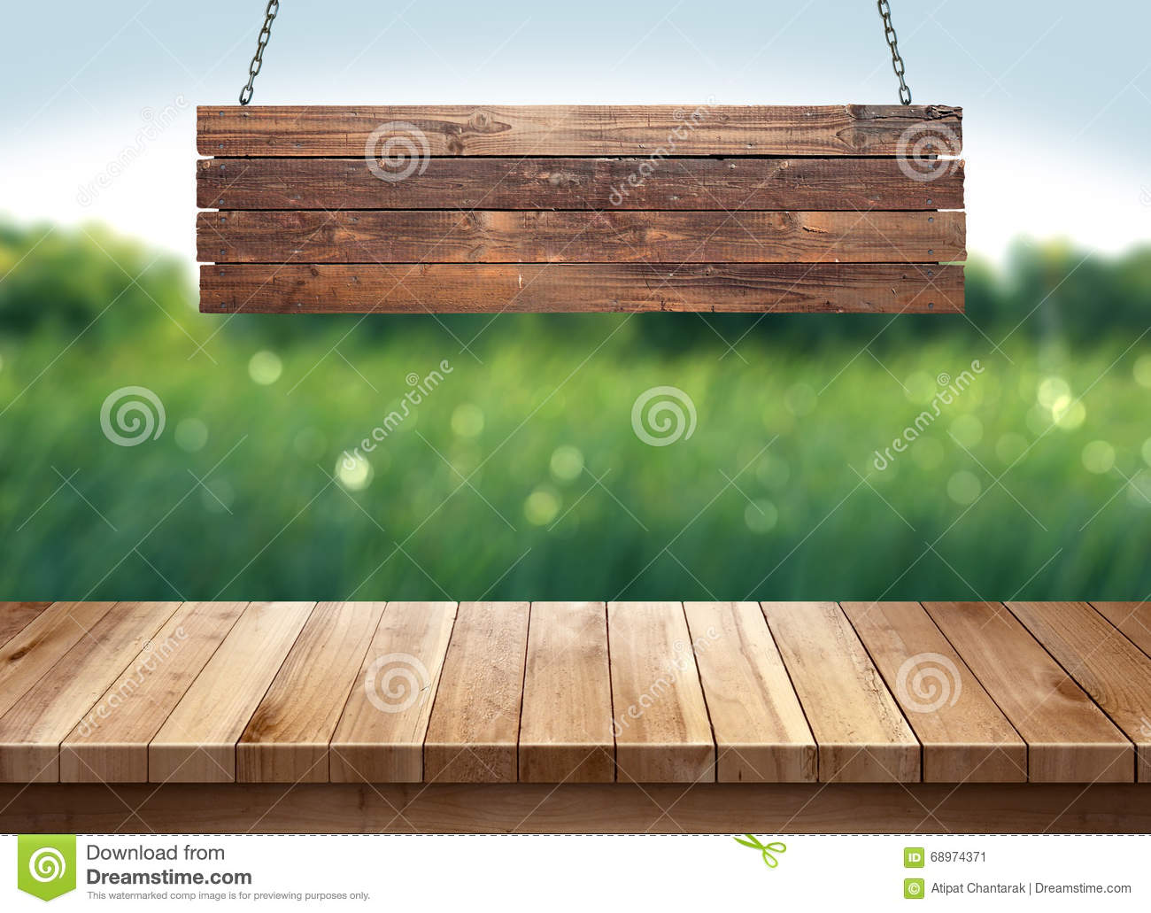 wood table with hanging wooden sign on green nature. Black Bedroom Furniture Sets. Home Design Ideas