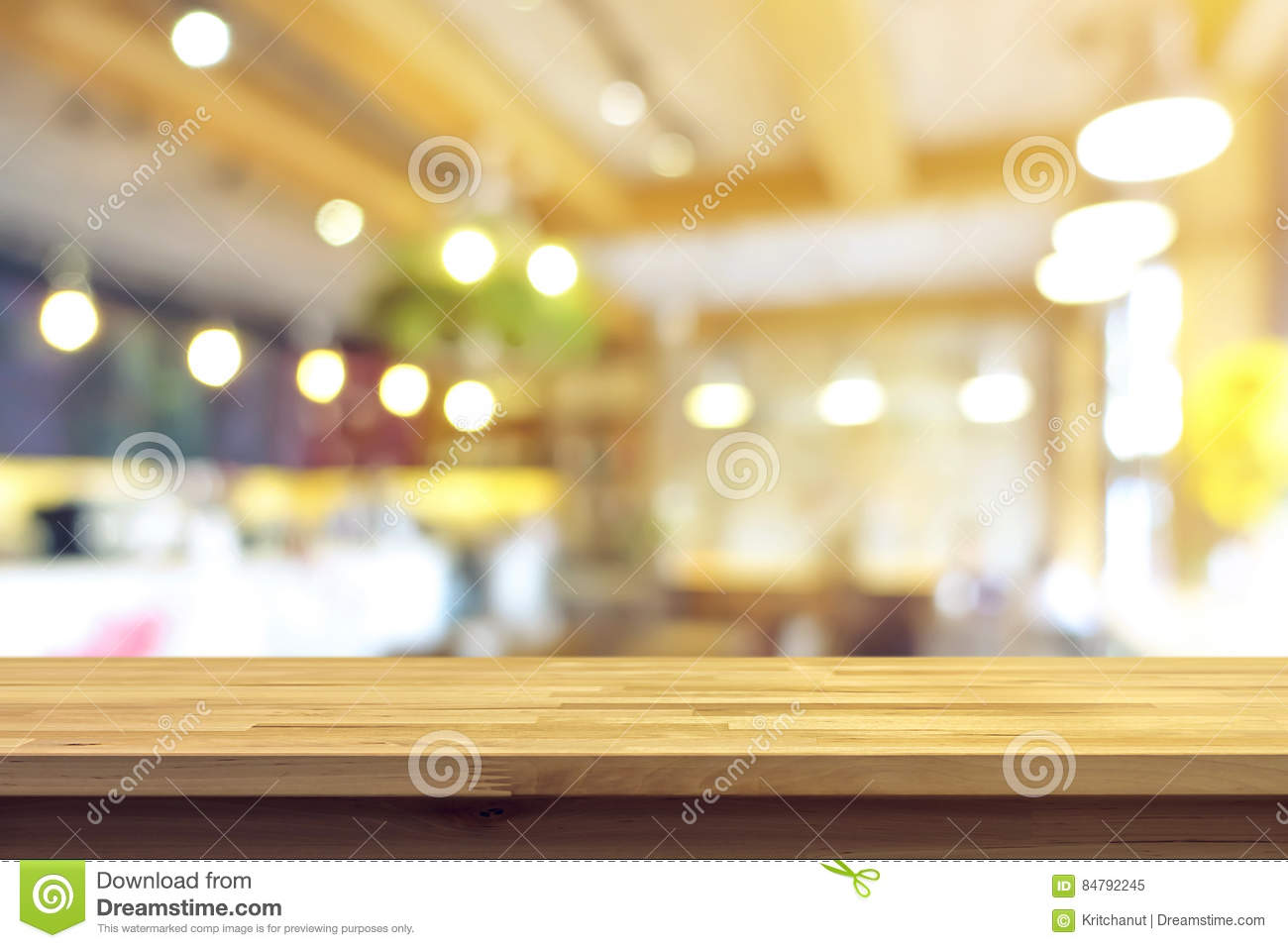 wood table top on blur cafe interior background stock photo