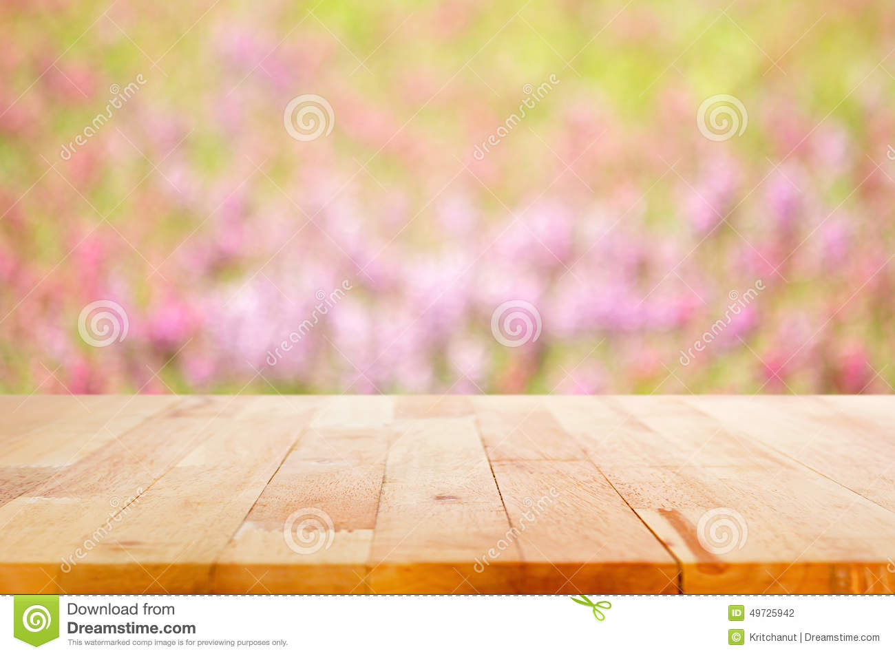 Wood Table Top On Blur Flower Garden Background Stock