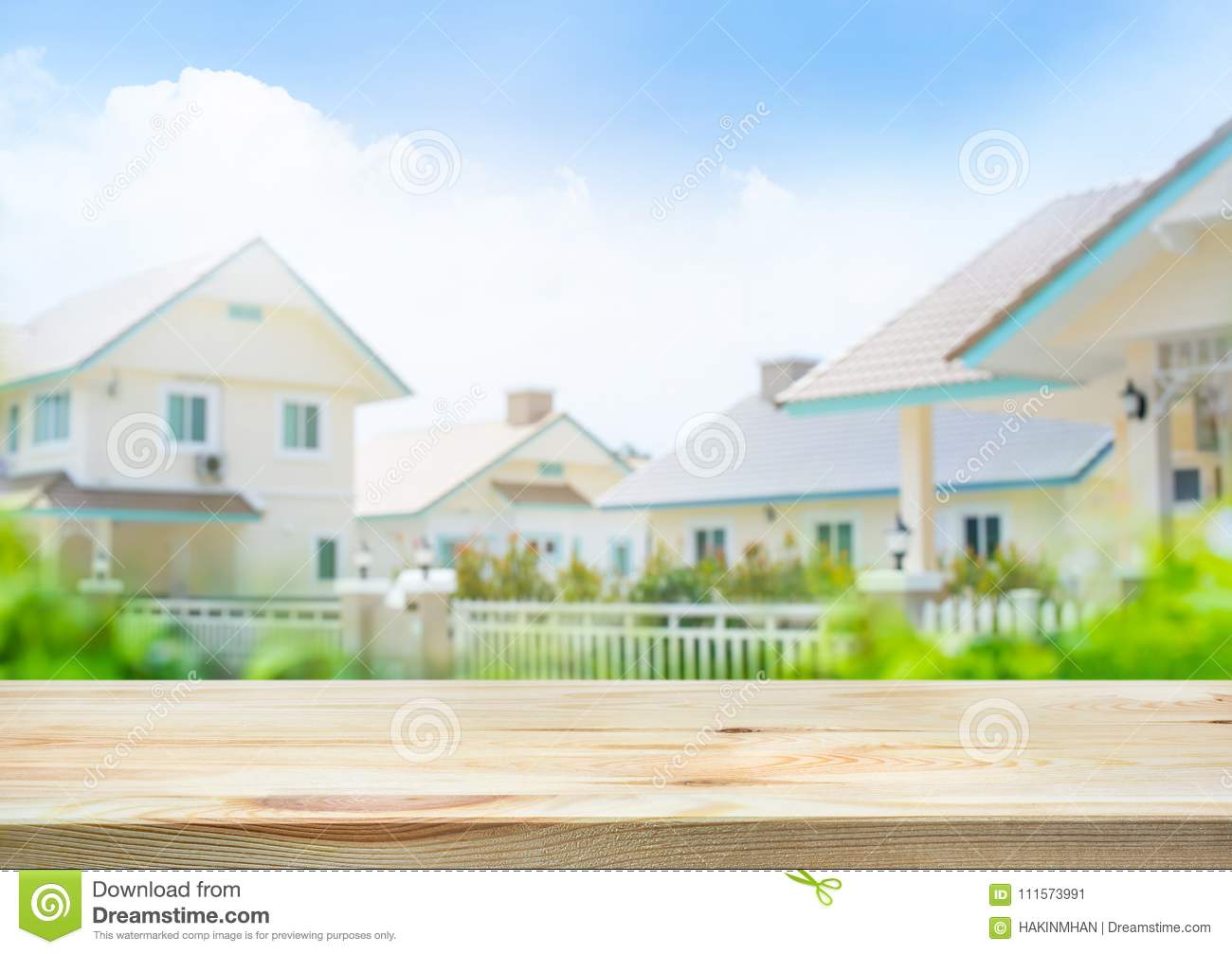 Wood Table Top On Blur Of House,home Village And White Fence Stock ...