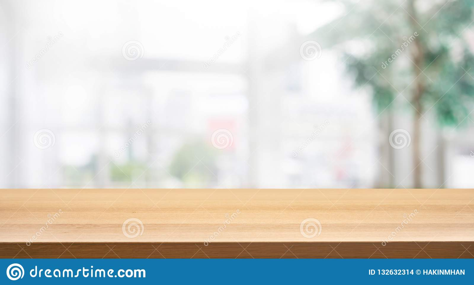 Wood table top on blur white glass wall background form office building