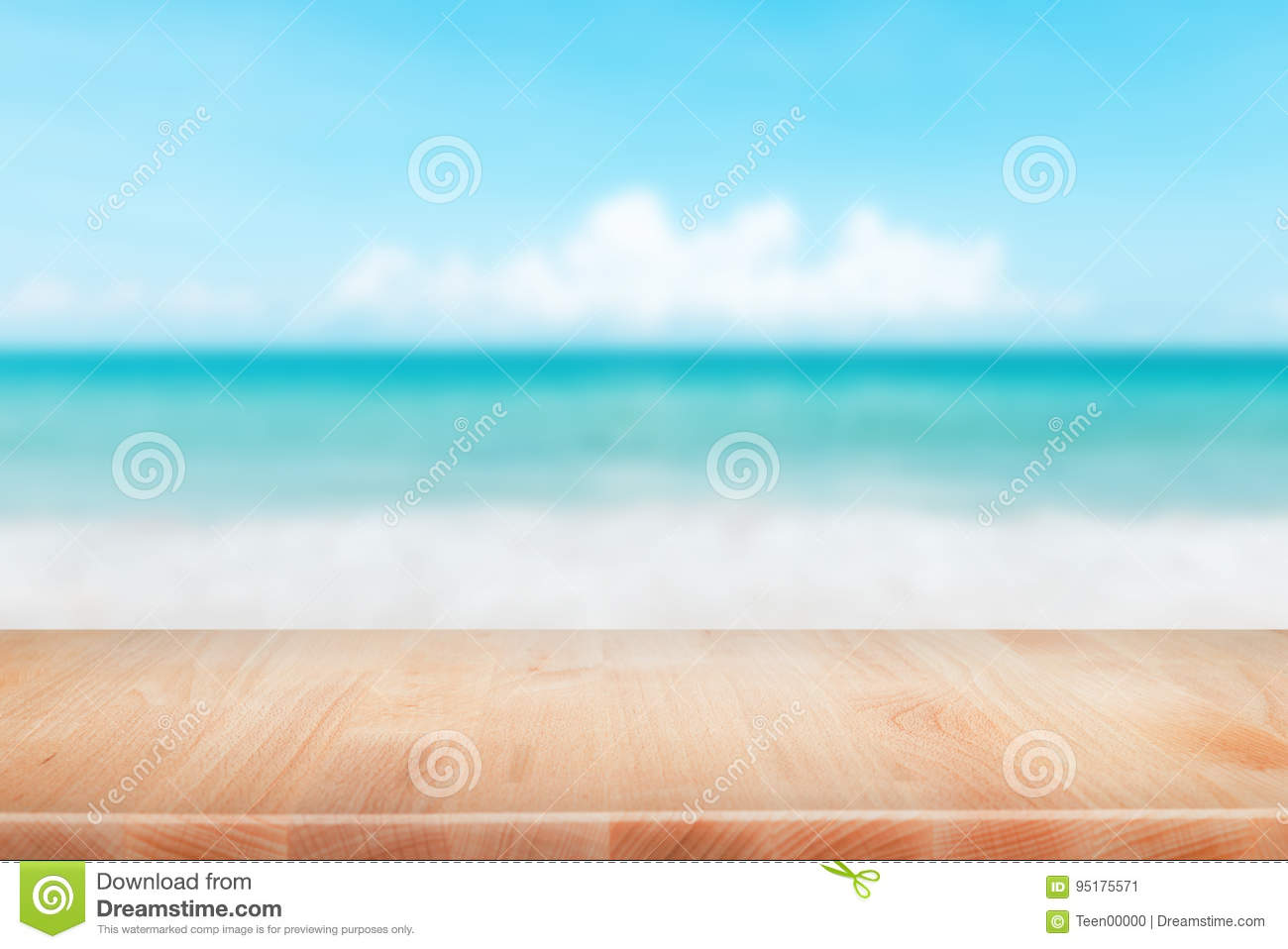 Wood table top on blurred blue sea and white sand beach backgrou
