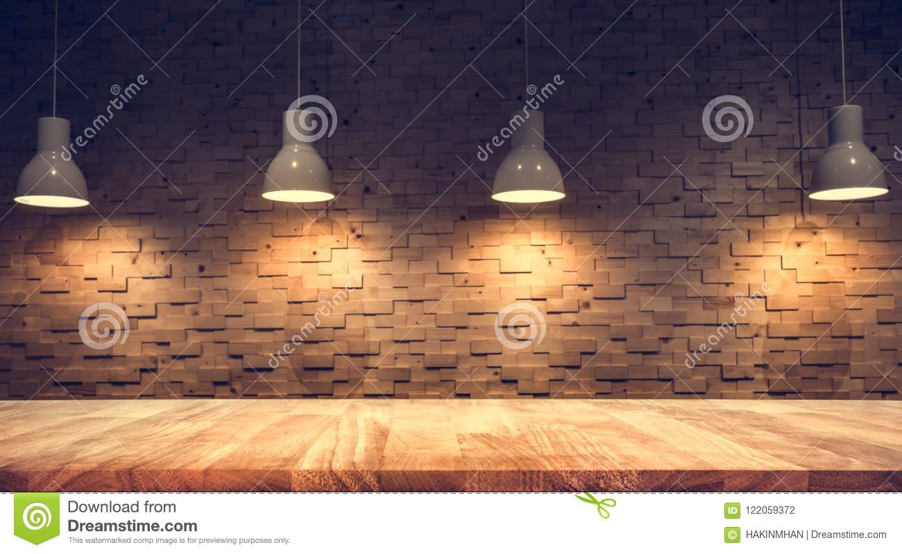 Wood table top on blurred of counter cafe shop with light bulb