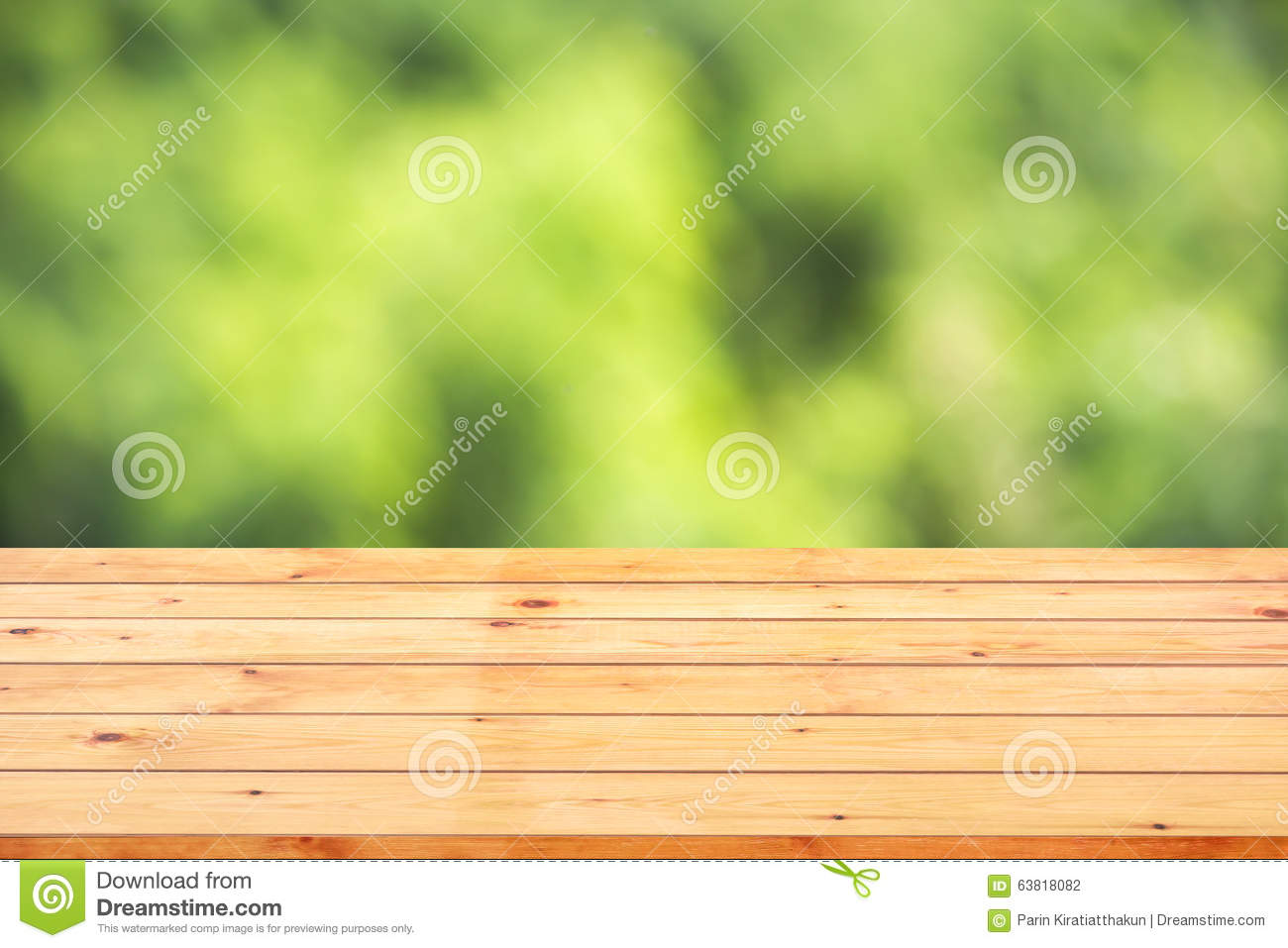 Wood Table Top On Bokeh Abstract Green Background Stock