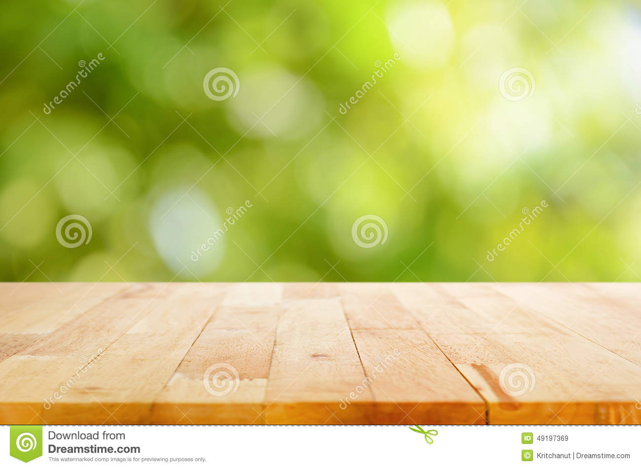 Wood table top on bokeh abstract green background