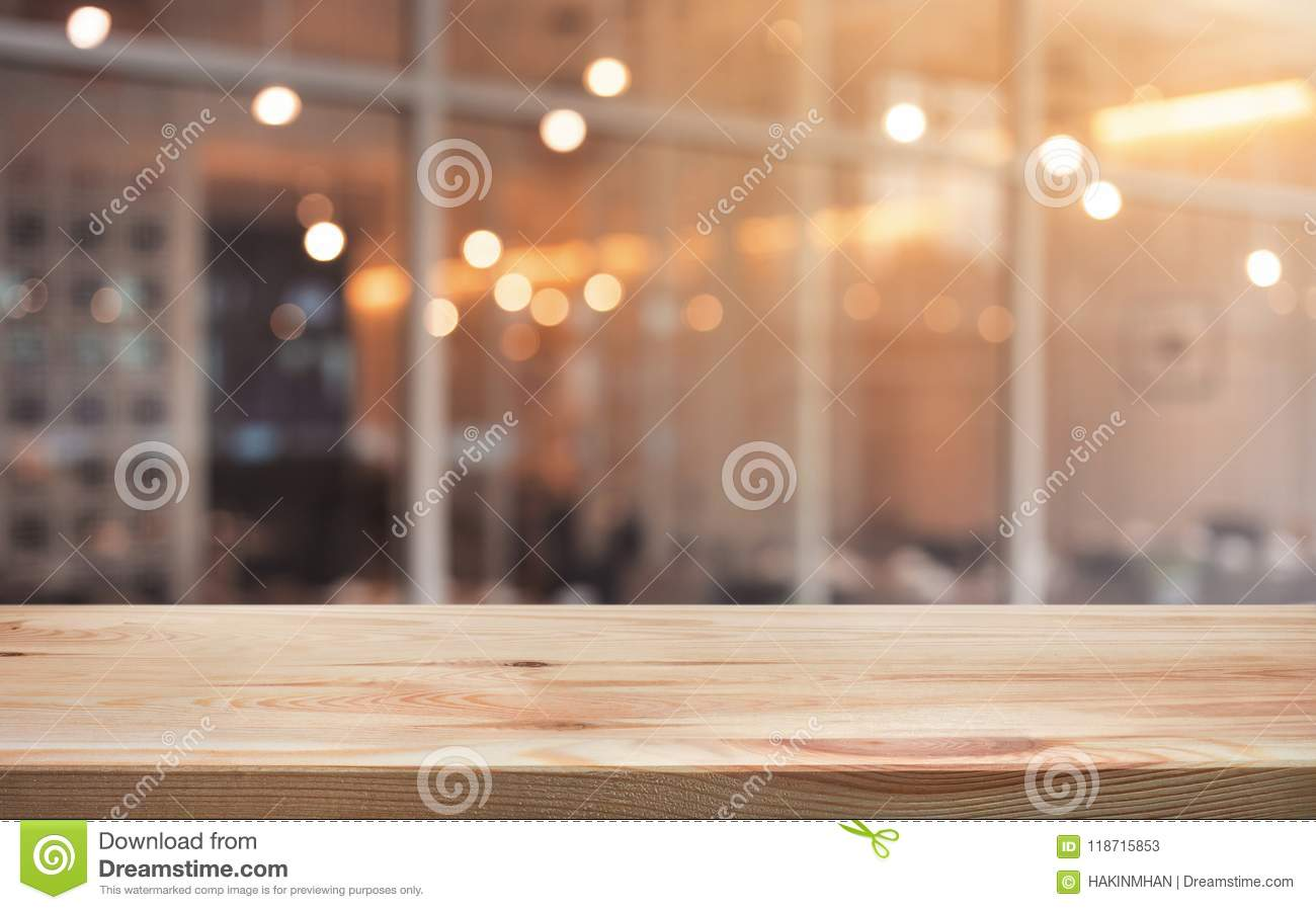 Wood table top with light gold cafe,restaurant background