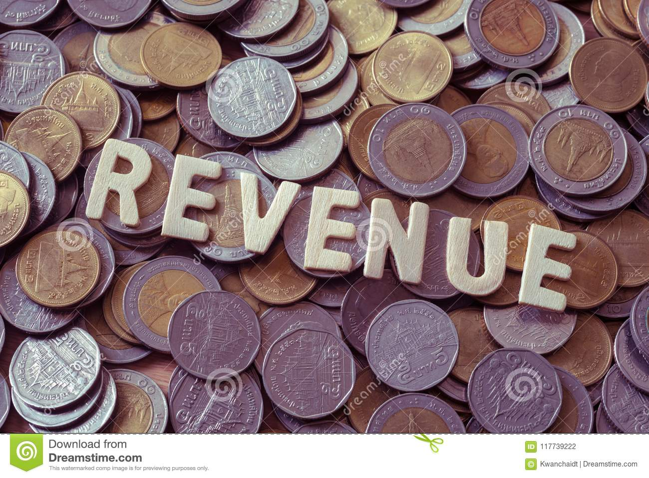 Wood Text REVENUE On Coins Background , Business And Finance Con