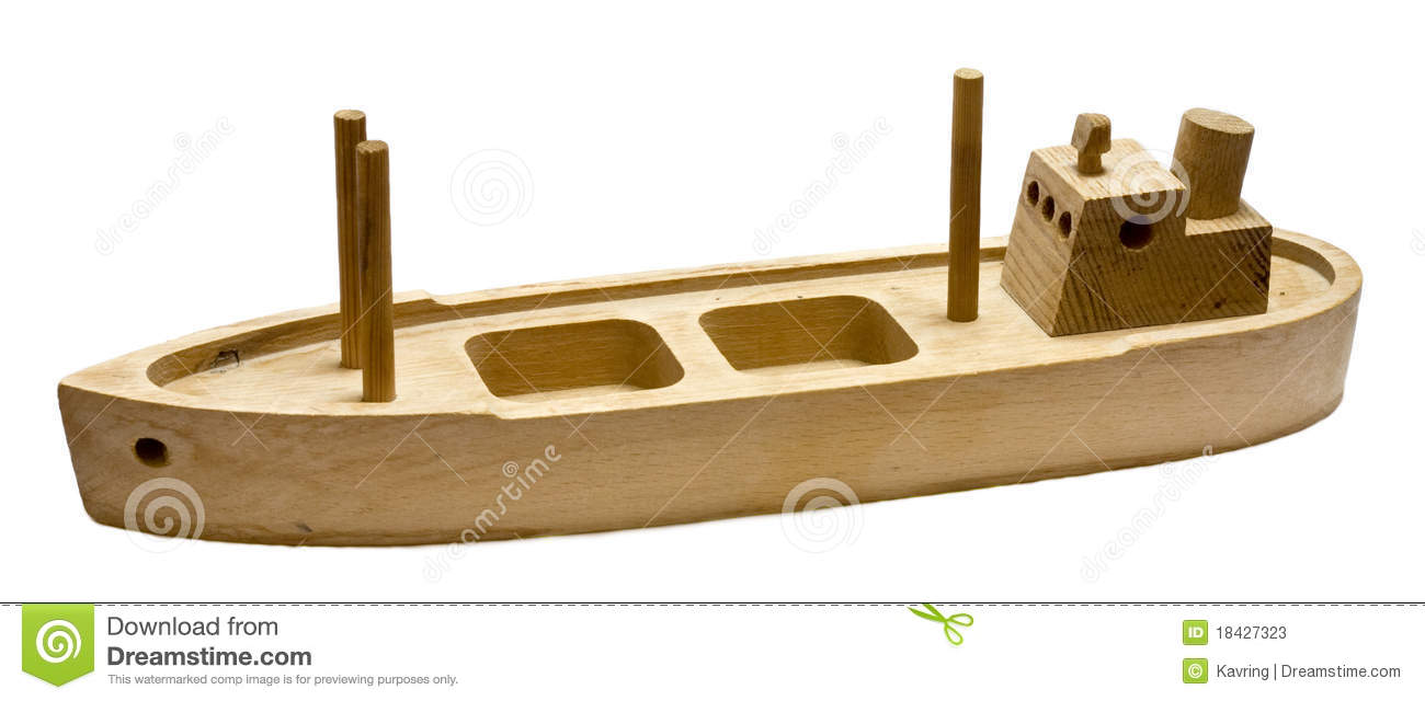Old wooden toy boat isolated on white background.