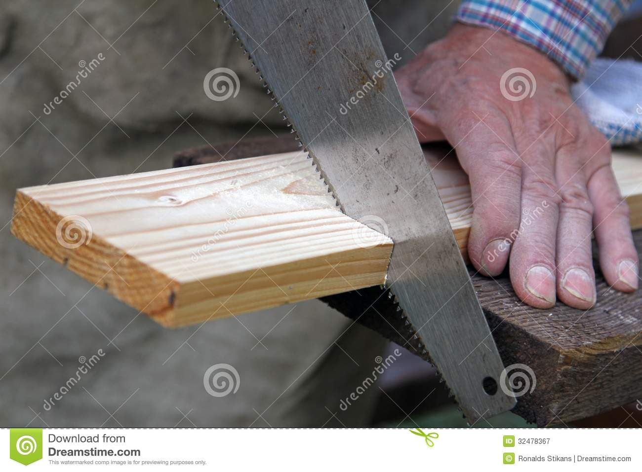 Wood Workshop Carpenter Cutting Plank With Hand Saw Stock Image