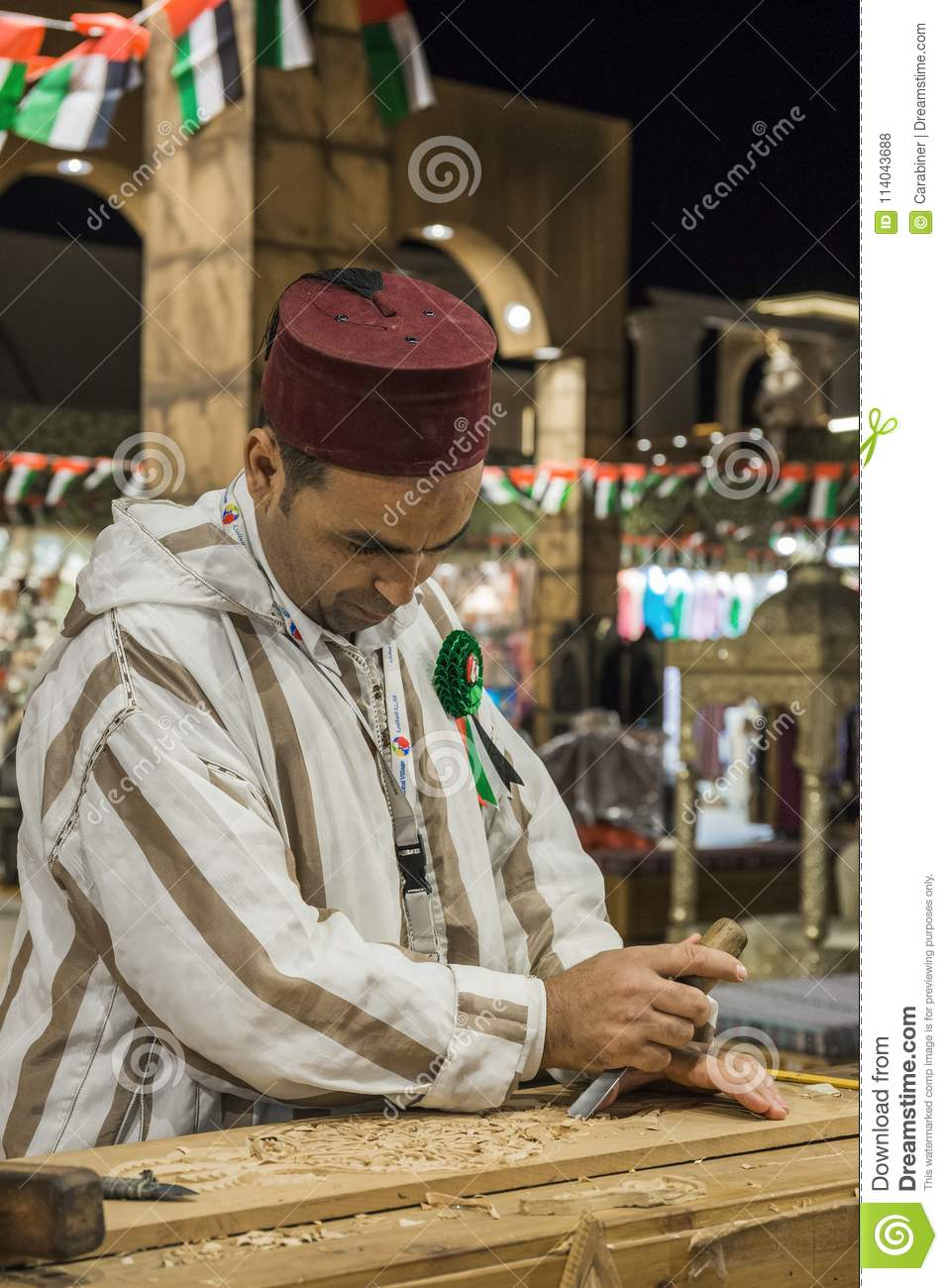 Woodcarver Artisan In National Clothes In The Pavilion Of