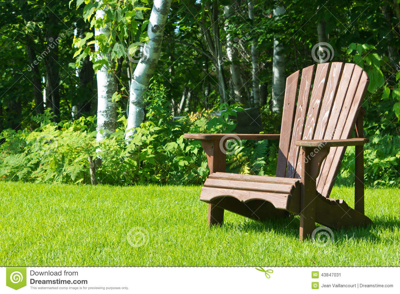 Wooden Adirondack Summer Lawn Chair Outside On The Green Grass Stock ...