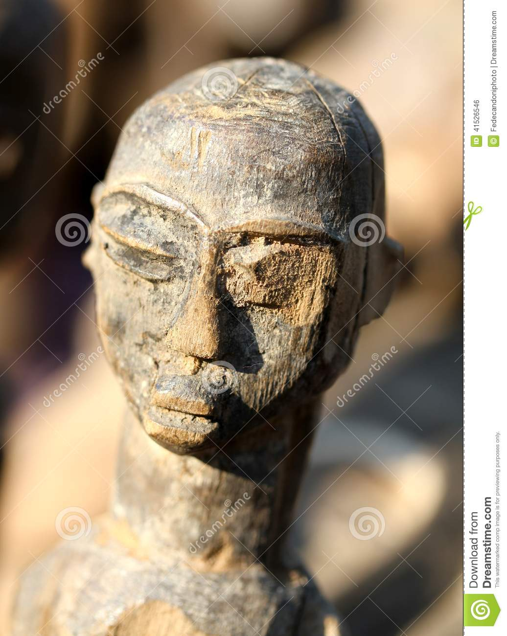 Wooden African mask that represents a woman s face made by hand