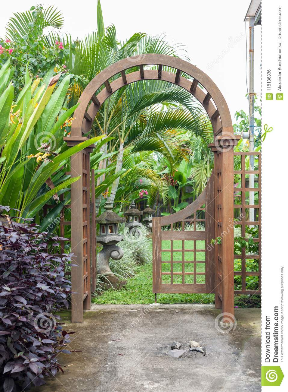 Download Wooden Arbor With Close On Half Gate In Garden. Wooden Arched  Entrance To The