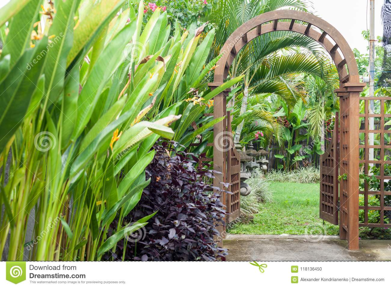 Download Wooden Arbor With Gate In Garden. Wooden Arched Entrance To The  Backyard. Stock