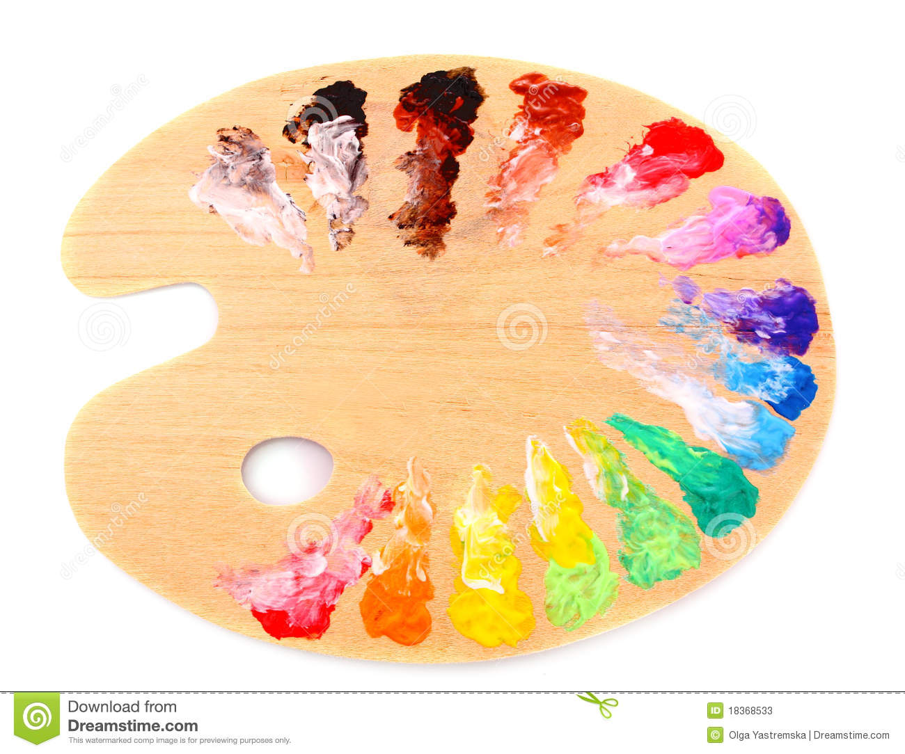 Wooden art palette with blobs of paint and a brush on white background ...