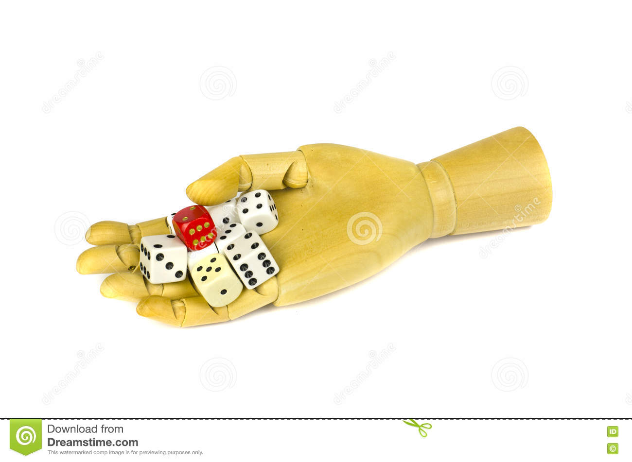 Wooden artist manikin hand with colorful bones dice