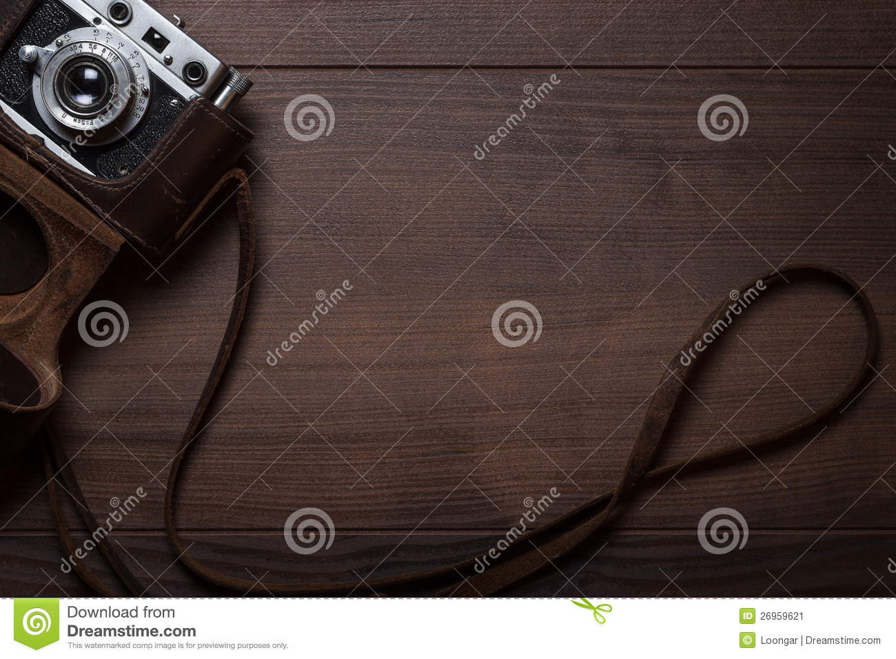 Wooden background with retro still camera