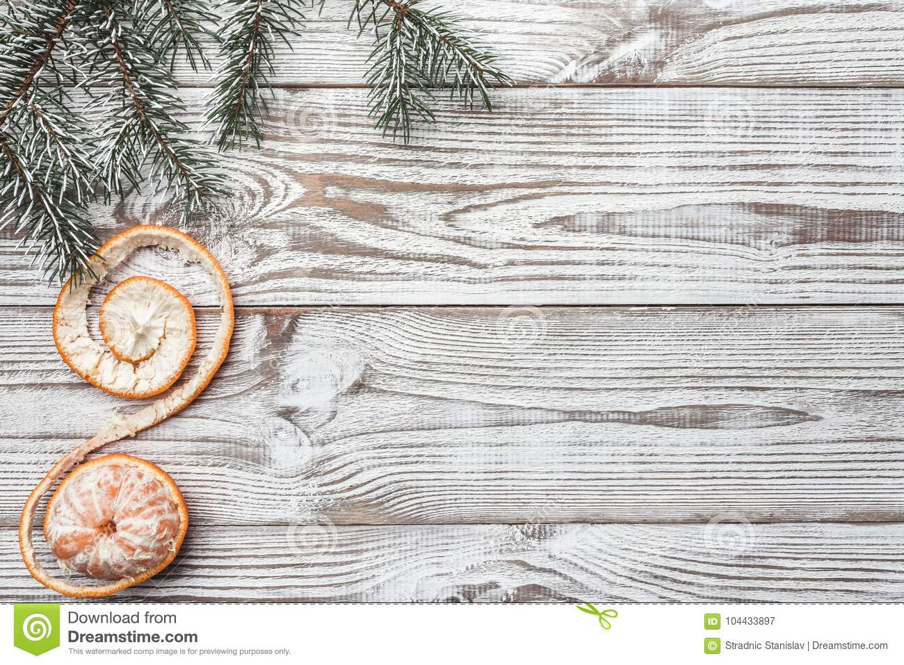 Wooden background. White. Winter card. Green fir branches. Tangerine. Xmas card. Space for Christmas or New Year`s greeting messa