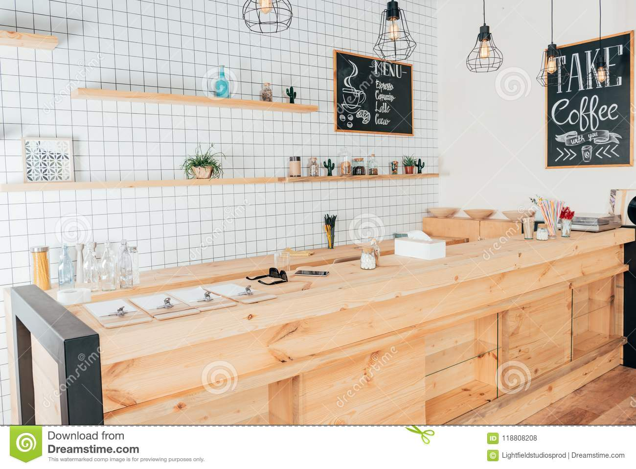 Wooden Bar Counter Of Modern Cafe Decorated With White Tiles Stock