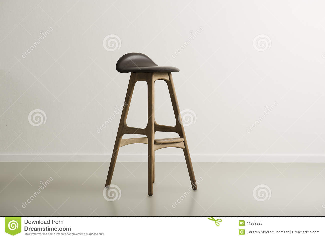 Wooden Bar Stool With A Molded Leather Seat Stock Photo