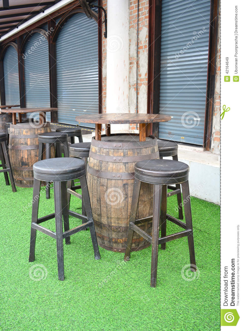 Wooden Barrel Table And Chairs In Empty Beer Garden Stock Photo