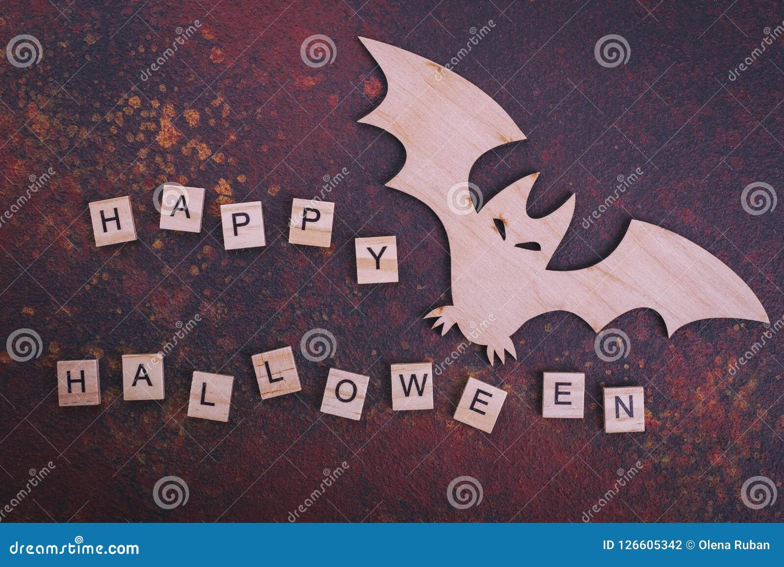 Wooden bat, text Happy Halloween