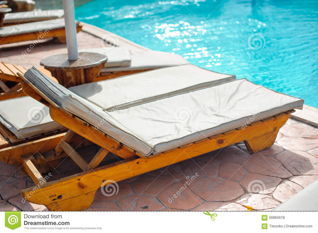 Pool Beds wooden bed beside the pool stock photo - image: 56865618