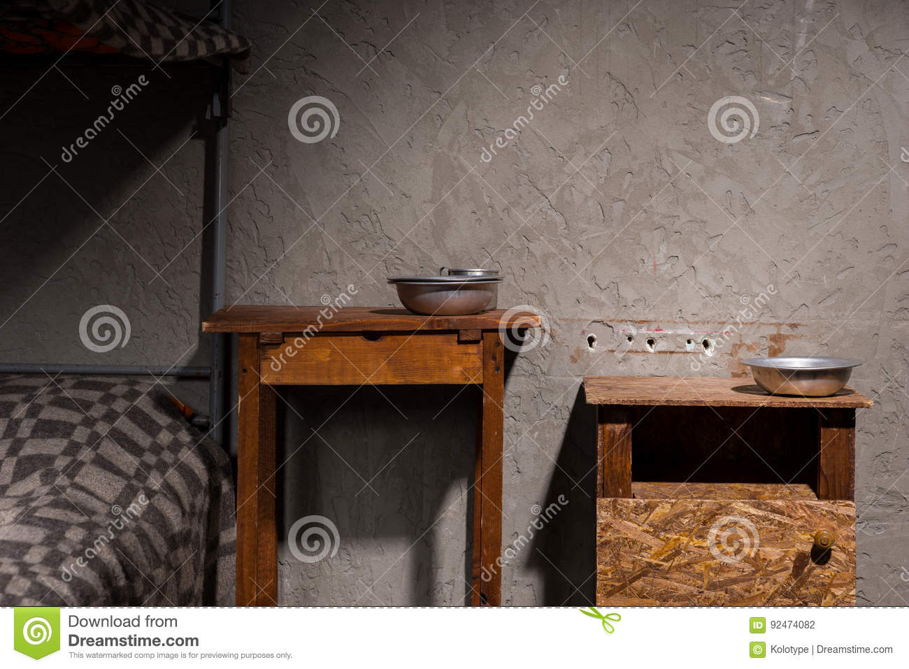 Wooden Bedside Tables With Aluminum Dishes Near Iron Bunk Bed In